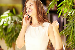 Phoning from mall Stock Photos