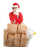 Phoning man in Santa clothes with paper bags Stock Photos