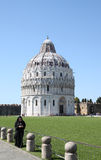 Phoning nun near Baptistry of St. John in Pisa Royalty Free Stock Photos