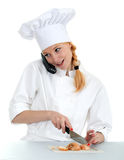 Phoning, smoking female cook cutting onion Stock Image