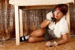 Phoning terrified woman Stock Photos