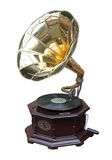 Phonograph. An old brass horn gramophone and record stock photo