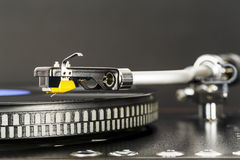 Phonograph cartridge waits over turntable Stock Image