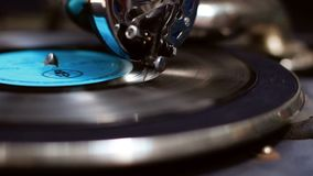 Phonograph close-up. Stylish vintage needle scratches vinyl record. Stock footage stock video