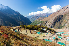 Phortse village houses green roofs above view, Nepal mountains. Royalty Free Stock Photos