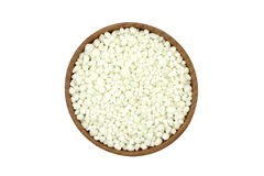 Phosphate fertilizer granules in a wooden bowl Royalty Free Stock Photography