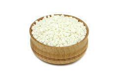 Phosphate fertilizer granules in a wooden dish Royalty Free Stock Image