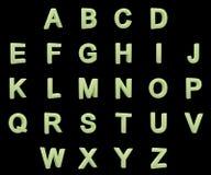 Phosphorescent capital letters alphabet Stock Images