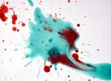 Phosphorescent czerwony akwareli pluśnięcie na białym tle Zdjęcie Royalty Free