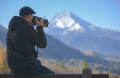Photgrapher taking picture of  a  mountain Royalty Free Stock Image