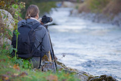 Photgrapher taking picture of  a  river Royalty Free Stock Image