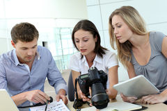 Photgraphers working at office. Team of photo reporters working in office stock photography