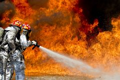 Photo of a 2 Fireman Killing a Huge Fire Royalty Free Stock Photos