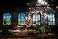 Photo of an Abandoned industrial interior with bright light Stock Photo