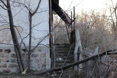Abandoned stairs at the entrance of the old house stock photography