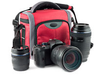 Photo accessories. Kit of camera, bag for the camera and extra lenses Stock Image