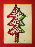 Photo of an actual christmas tree prepared and painted by a child royalty free stock photos