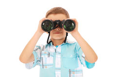 Photo of an adorable boy watching after binoculars. Isolated in white stock images