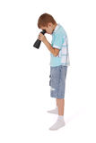 Photo of an adorable boy watching after binoculars Stock Images