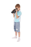 Photo of an adorable boy watching after binoculars Royalty Free Stock Photos