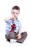 Photo of adorable young boy with red lamp Stock Photography