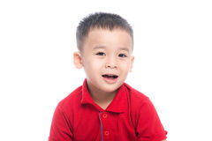 Photo of adorable young happy asian boy looking at camera. Stock Images