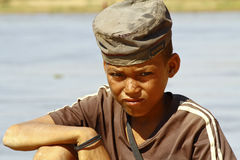 Photo of adorable young happy boy - african poor child on the ri Stock Photo
