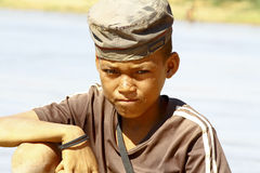 Photo of adorable young happy boy - african poor child on the ri Stock Image