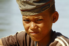 Photo of adorable young happy boy - african poor child on the ri Stock Photography