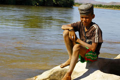 Photo of adorable young happy boy - african poor child on the ri Stock Photos