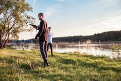 Adult guy and girl play with a kite royalty free stock image