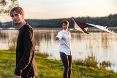 Adult guy and girl play with a kite stock image