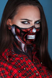 Photo of adult woman with scare mae up for halloween night Royalty Free Stock Photo
