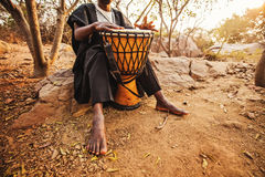 Photo of an african drummer playing. Faceless photo of an african drummer playing Royalty Free Stock Image
