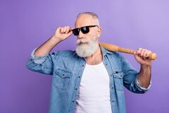 Photo of aged man serious confident hold baseball bat sportive hand touch sunglass isolated over violet color background