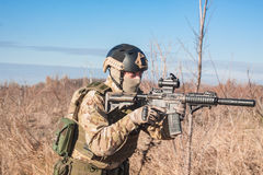 Photo of airsoft soldier in fields. Airsoft player in NATO soldier uniform training in fields fith rifle stock images