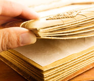 Photo album. Man's hand opening an old photo album Stock Photography