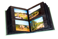 Photo album. A black open photo album with travel photographs from South Africa. Image isolated on white studio background stock photos