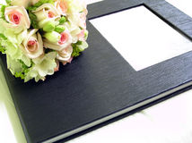 Photo album. Roses and photo album. Front cover with a frame for adding content stock photos