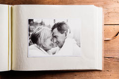 Photo album with black-and-white picture of senior couple. Stock Photos