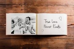 Photo album with black-and-white picture of senior couple. Stock Photo