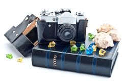 Photo album and camera Royalty Free Stock Images