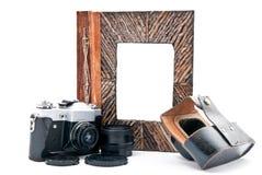 Photo album and camera Stock Photos
