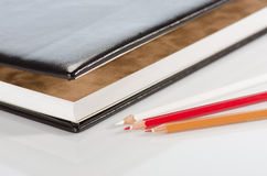 Photo album and color pencils Royalty Free Stock Photos