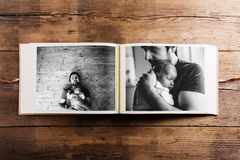 Photo album with pictures of father and baby girl. Fathers day. Photo album with pictures of young father and his cute newborn baby daughter. Fathers day Stock Photos