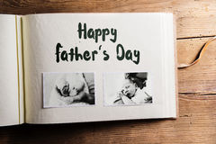 Photo album with pictures of father and baby son. Fathers day. Photo album with pictures of young father and his cute newborn baby son. Fathers day concept Stock Photo
