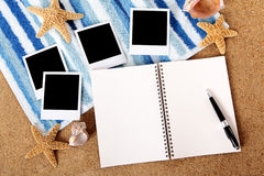 Photo album polaroid frame photo prints, beach background, copy space Stock Photo