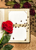 Photo album and red roses on coffee seed Stock Photo