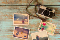 Photo album of remembrance, love and nostalgia in summer journey trip on wood table. Instant photo of camera - vintage and retro style Stock Images