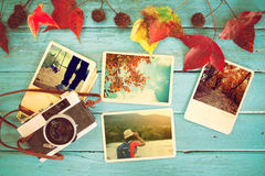 Photo album in remembrance and nostalgia in autumn fall season on wood table. Instant photo of retro camera - vintage and retro style Royalty Free Stock Photos